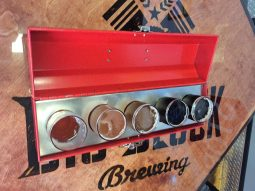 Beer samples served in red tool box.
